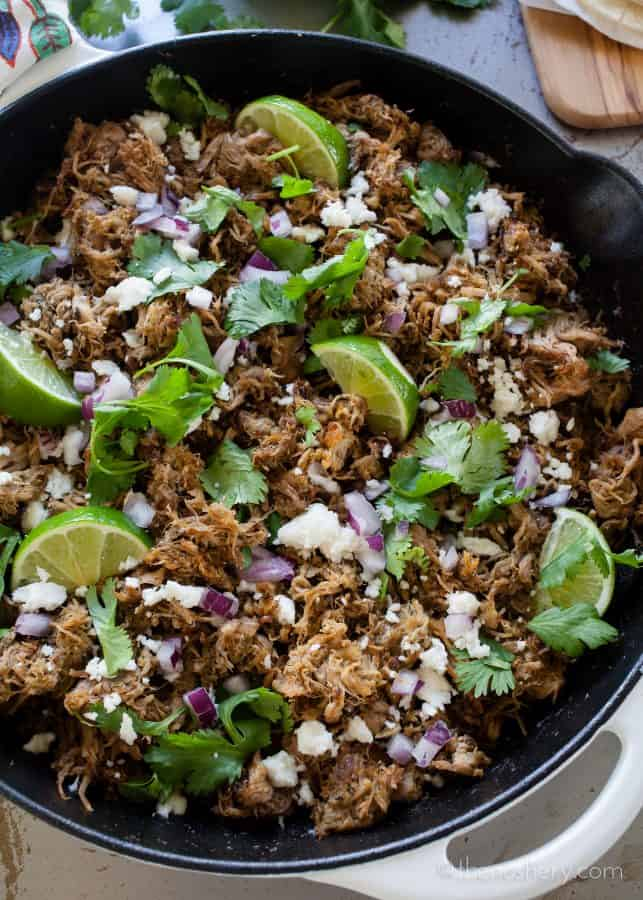 Slow Cooker Pork Carnitas Recipe | Make taco night a special night! Ditch the ground beef with the taco seasoning and try these easy and flavorful slow cooker pork tacos. | The Noshery