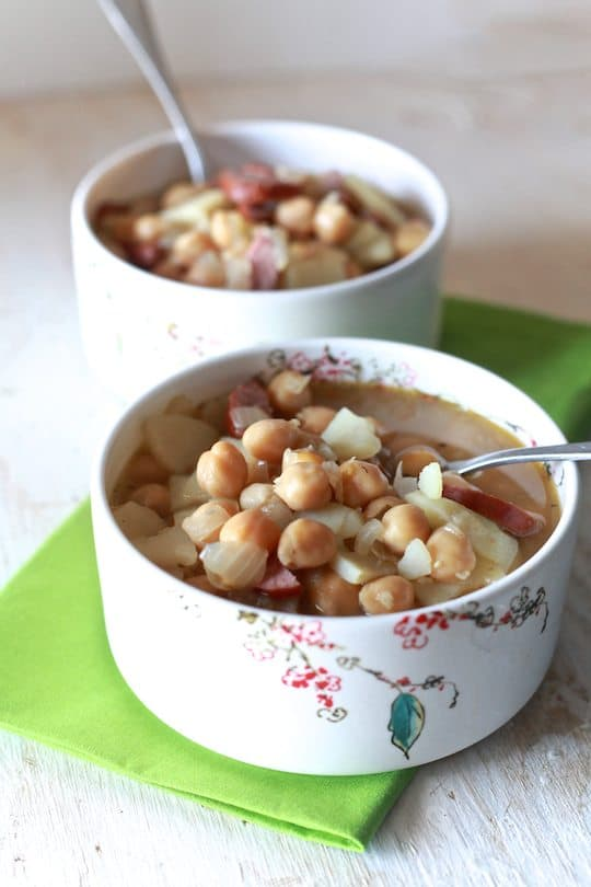 Spanish Bean Soup | Savory soup of garbanzo beans, potatoes and spicy sausage in a chicken broth. | TheNoshery.com - @TheNoshery