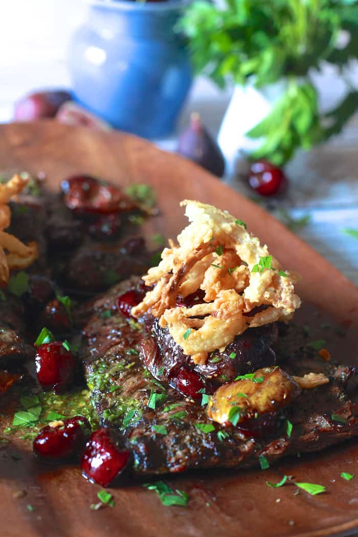 Grilled Skirt Steak with Roasted Cherries and Figs with Crispy Onions | The Noshery