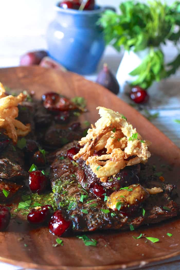 Grilled Skirt Steak with Roasted Cherries and Figs with Crispy Onions - TheNoshery.com