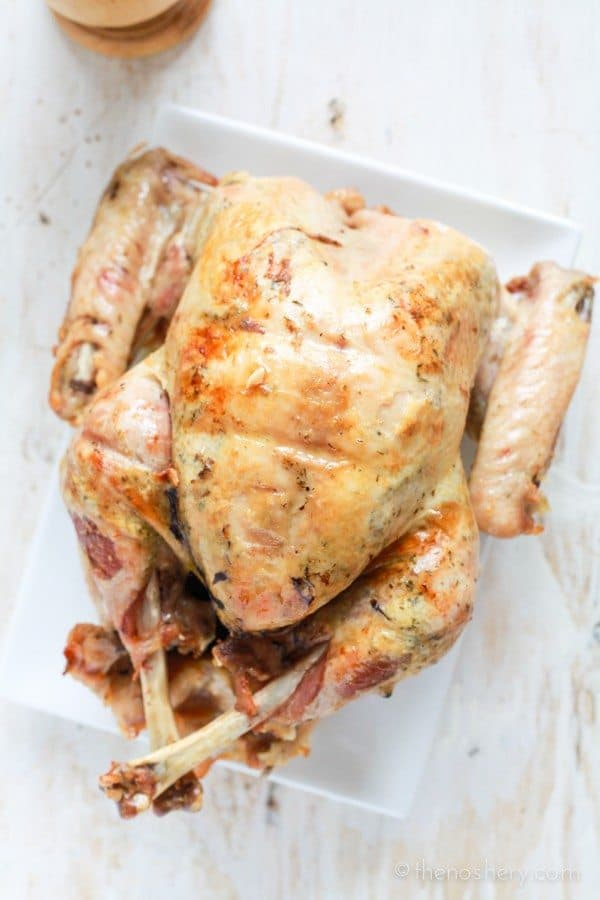 Puerto Rican Thanksgiving Turkey: Pavochon - Turkey seasoned to tasted like pork. Roasted breast down for a fool proof juicy and flavorful breast. | TheNoshery.com