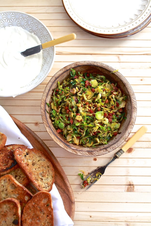 Brussels Sprouts and Ricotta Toast | Hearty toast topped with whipped ricotta cheese, shaved brussels sprouts and pancetta. | TheNoshery.com - @thenoshery