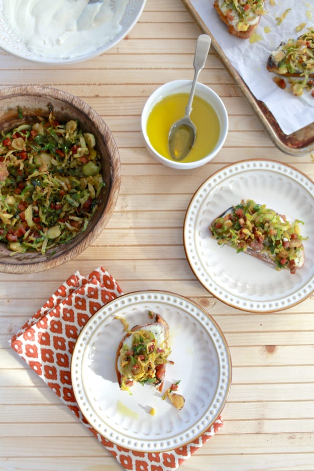 Brussels Sprouts and Ricotta Toast | Hearty toast topped with whipped ricotta cheese, shaved brussels sprouts and pancetta.
