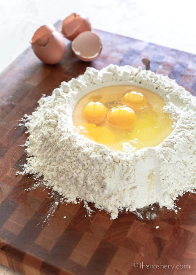 Homemade Pasta | Mound of flour with well in the center filled with eggs. | The Noshery