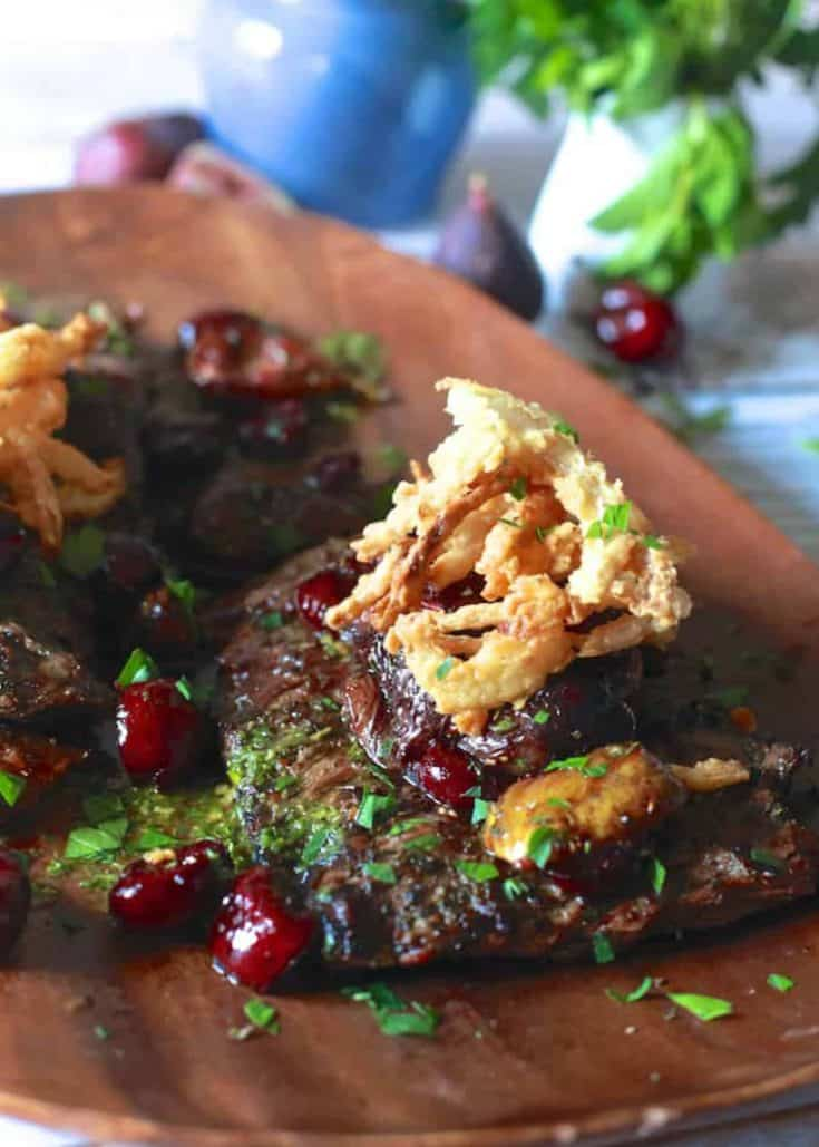 Grilled Skirt Steak with Roasted Cherries and Figs with Crispy Onions