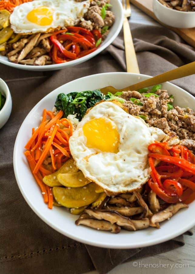 Overhead shots of Ground Pork Bulgogi + Cauliflower Rice | Sautéed vegetables, with a fried egg, and ground pork