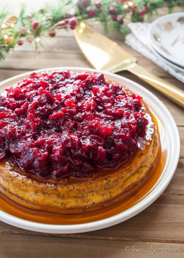 Chai Spiced Orange Flan with Cranberry Compote | Creamy cheese flan spiced with chai and orange and then topped with a sweet and tart cranberry compote. A perfect holiday dessert! | The Noshery
