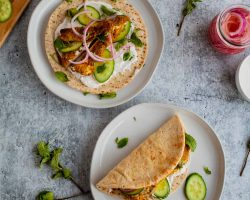 Chicken Shawarma Pitas | These chicken pitas are an adaptation of the popular middle eastern street food shawarma. The chicken tenderloins are rubbed with shawarma spices and served in a warm pita with tangy yogurt. This flavor bomb is a perfect weeknight meal | The Noshery