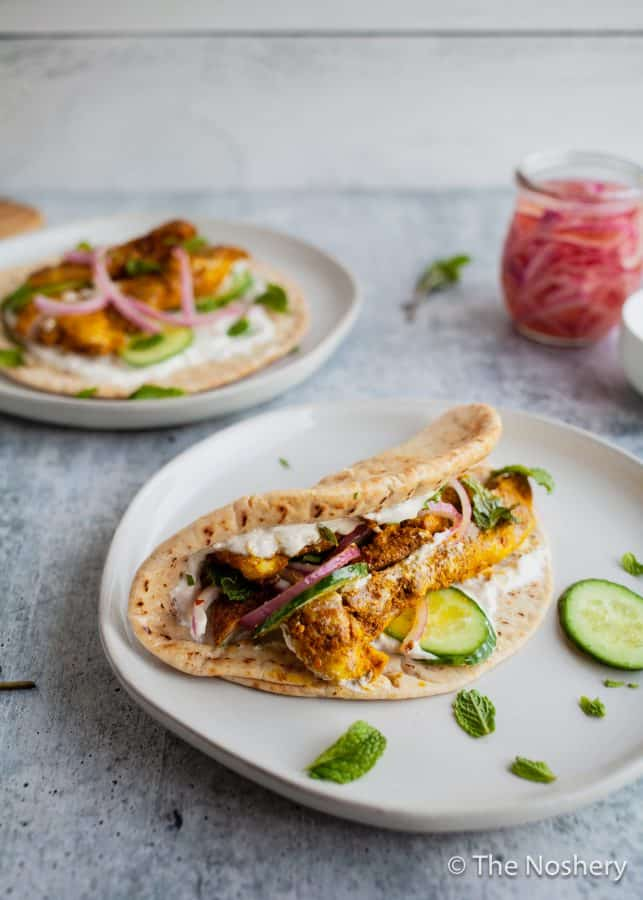 Chicken Shawarma Wraps | These chicken pitas are an adaptation of the popular middle eastern street food shawarma. The chicken tenderloins are rubbed with shawarma spices and served in a warm pita with tangy yogurt. This flavor bomb is a perfect weeknight meal | The Noshery