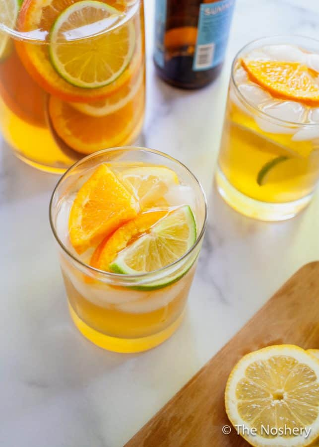 Summer Shandy Sangria | A combination of beer, lemonade, and fresh fruit is the marriage of two favorite summer drinks, shandy and sangria. | The Noshery